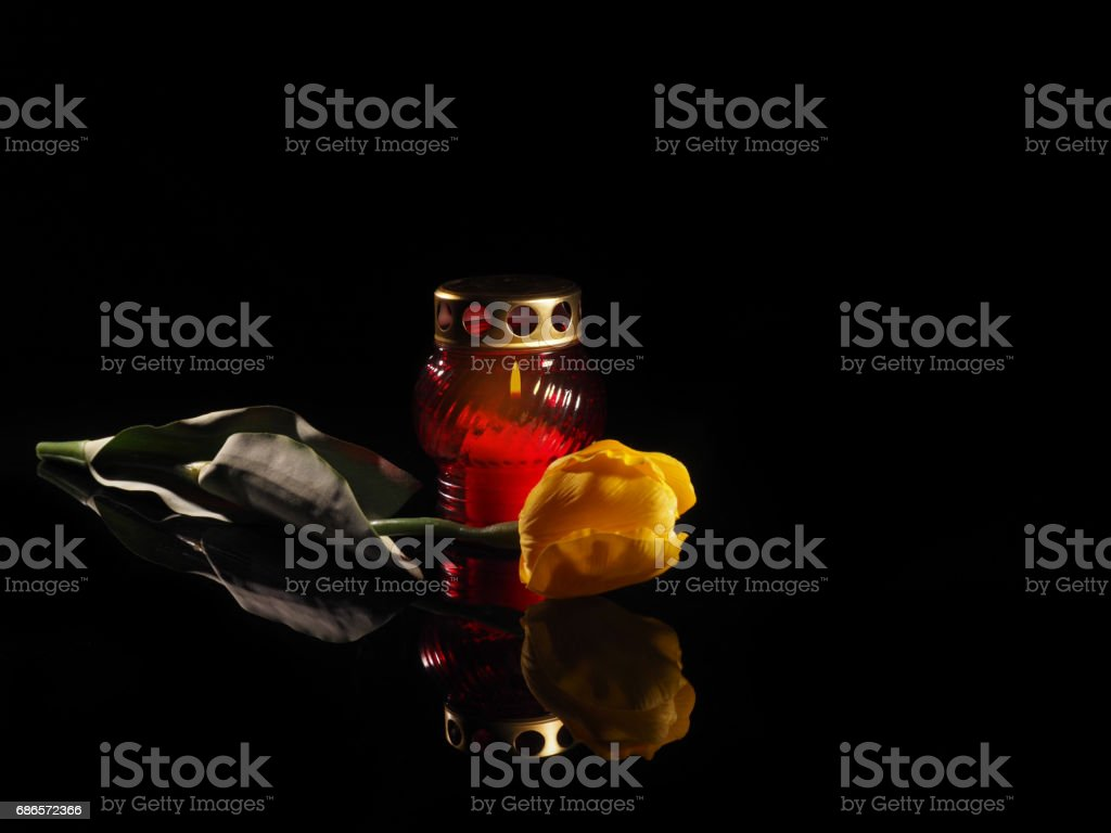 Burning candle in a red glass candlestick royalty-free stock photo