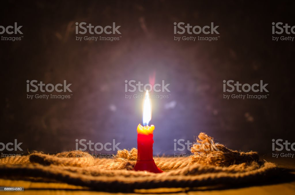 Burning candle on a table royalty-free stock photo