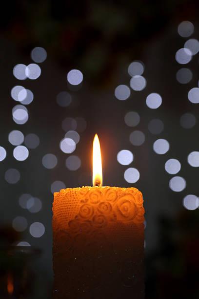 burning candle on blurred background stock photo