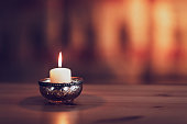 burning candle on the table
