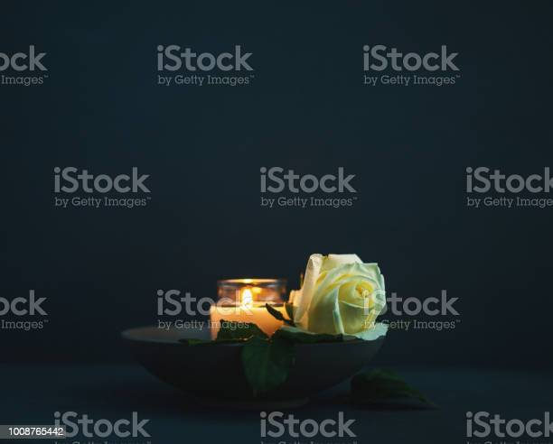 Burning candle with white rose in remembrance picture id1008765442?b=1&k=6&m=1008765442&s=612x612&h=mts1b6yblfqixglousw3padjjwt4u6nt6dno15tkfq8=