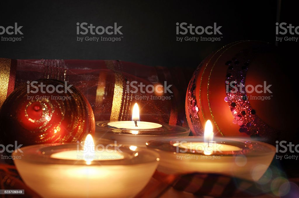 burning candles and Christmas balls stock photo