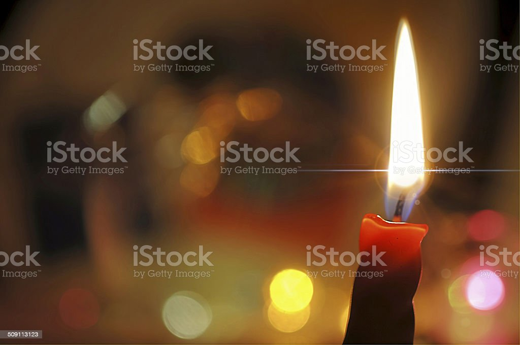 burning candles and colorful lights stock photo