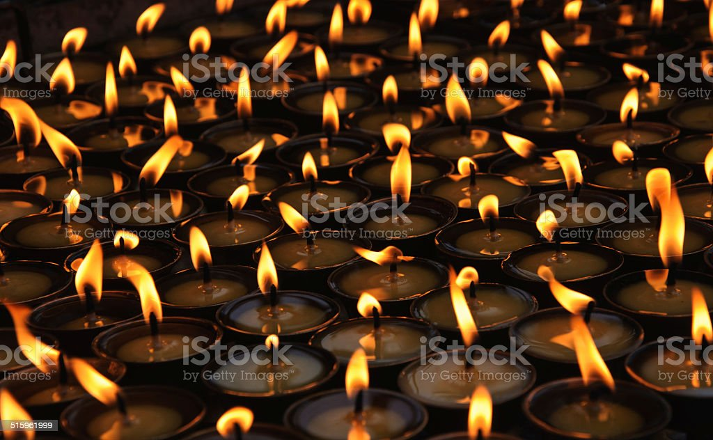 Burning candles at a Buddhist temple stock photo