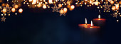 istock Burning candles in christmas night 1283529448