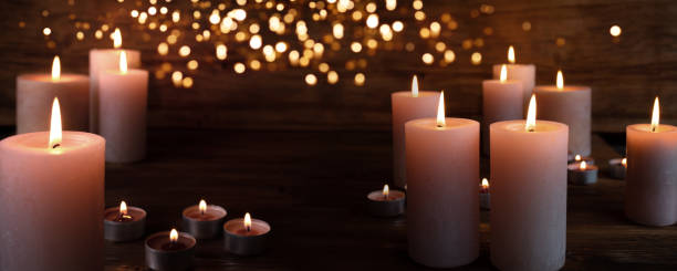Burning candles in darkness Burning candles in darkness with light effects religious celebration stock pictures, royalty-free photos & images