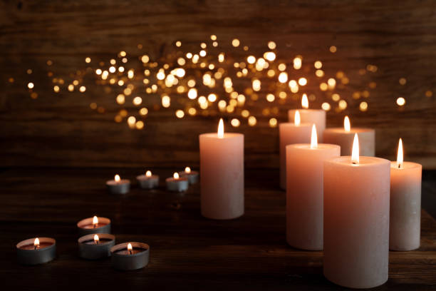 Burning candles in darkness stock photo