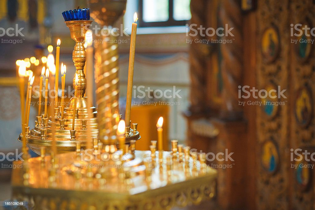 Burning candles in ortodox church royalty-free stock photo