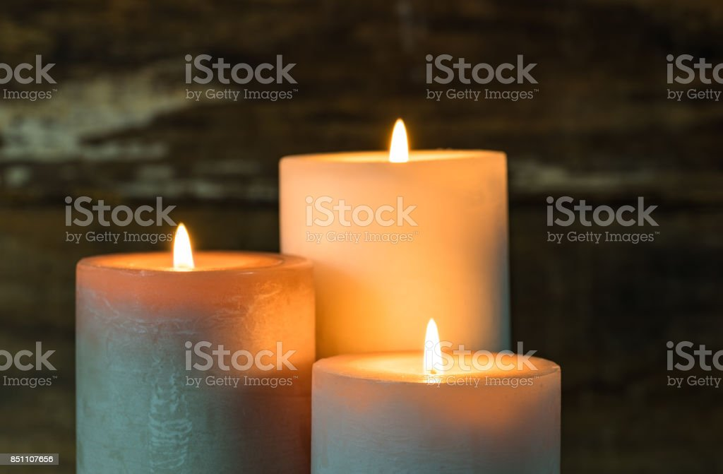 Burning candles in the dark. royalty-free stock photo
