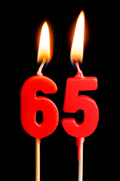 Burning Candles In The Form Of 65 Sixty Ive Figures Numbers Dates For