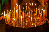 Burning candles candles in the Holy Sepulcher on Mount Calvary, Jerusalem, Israel
