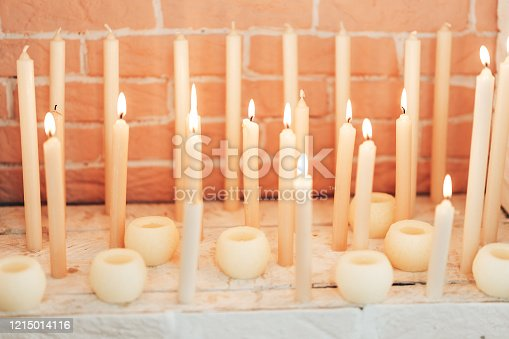 Burning candles. Many candles burning at night. Abstract candles background. Close-up.