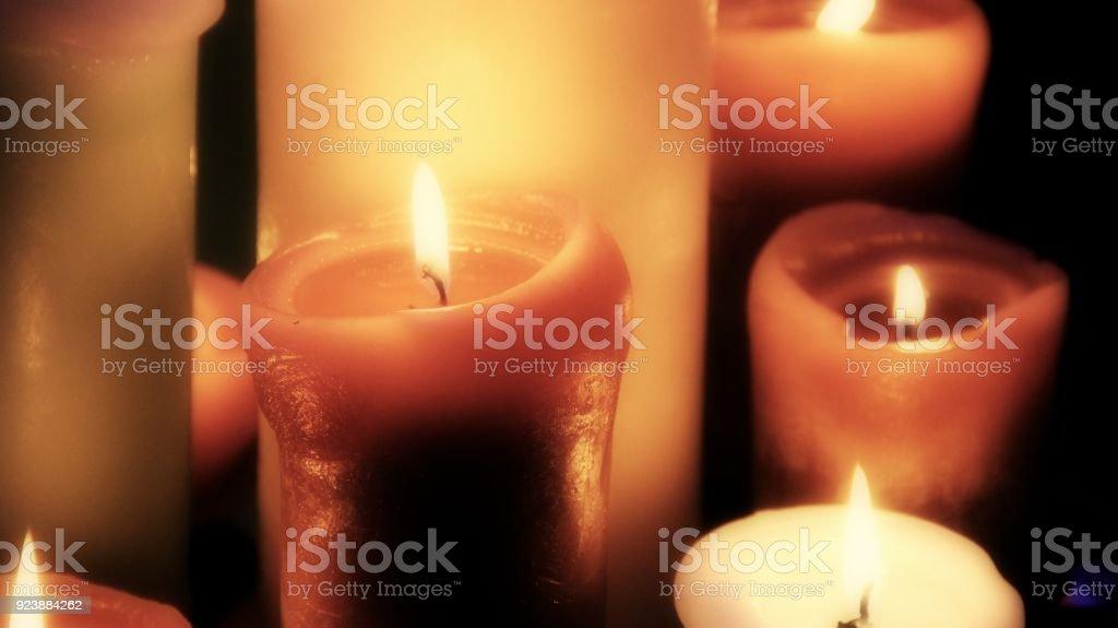 Burning candles on black background closeup stock photo