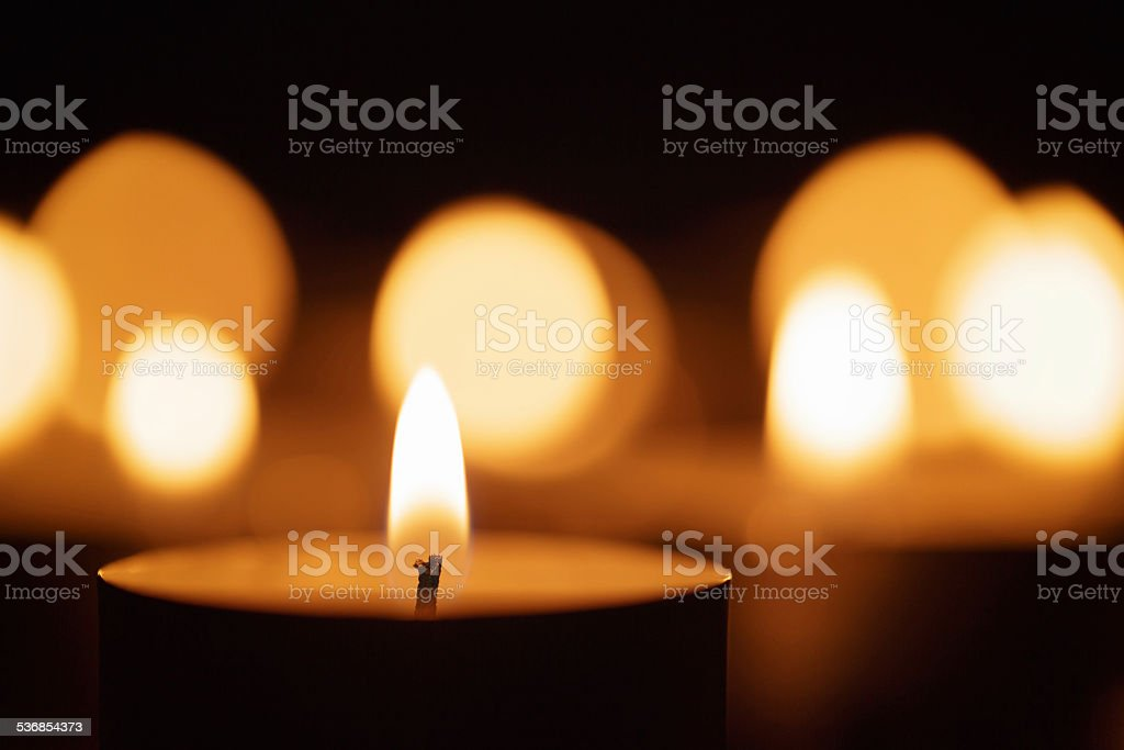burning candles with beautiful out of focus stock photo