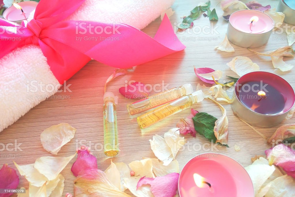 Burning Candles With Essential Spa Oil Rose Flower Petals