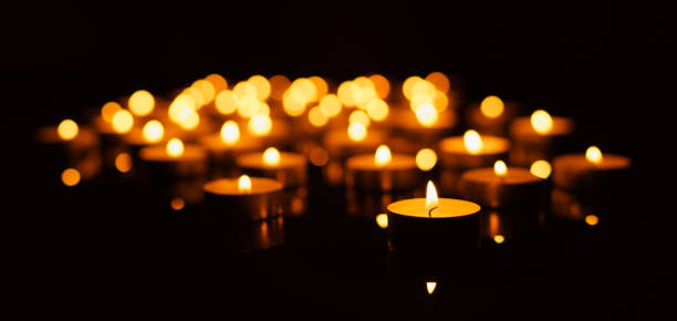 burning candles with shallow depth of field - candle stock pictures, royalty-free photos & images