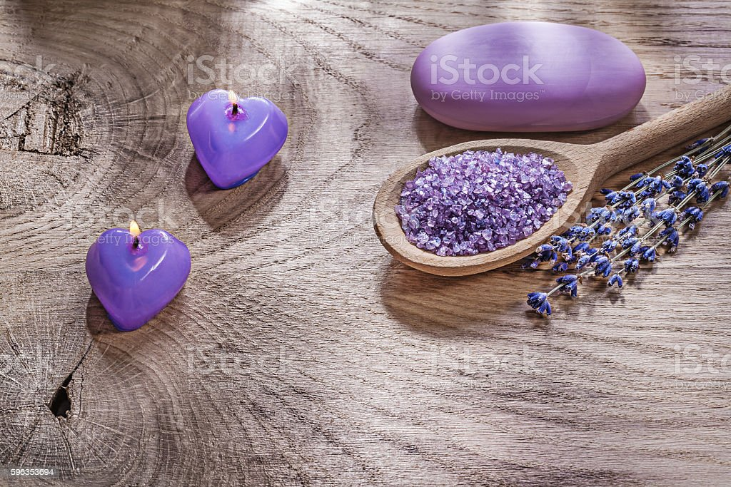Burning candles wooden spoon sea salt dry lavender bar of royalty-free stock photo