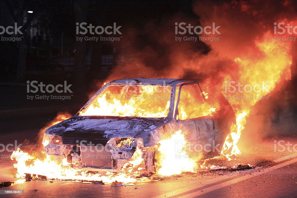 Burning car on fire on the road stock photo
