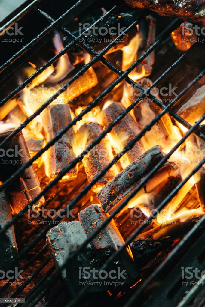 Burning charcoal with fire on the stove with grill on top in Bangkok, Thailand. stock photo