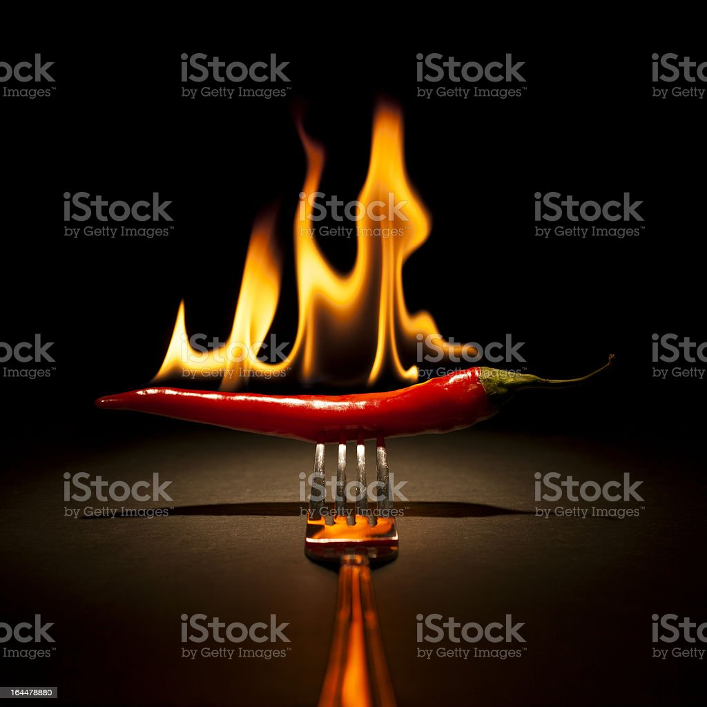 Burning Chili Pepper - Fire Flame Fork Hot Red stock photo
