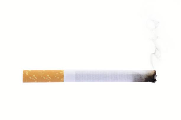 Burning cigarette smoke isolated on white background smoking stock photo