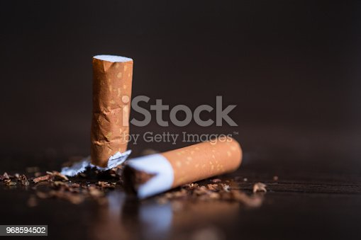 Burning cigarette with smoke and concept of cigarettes