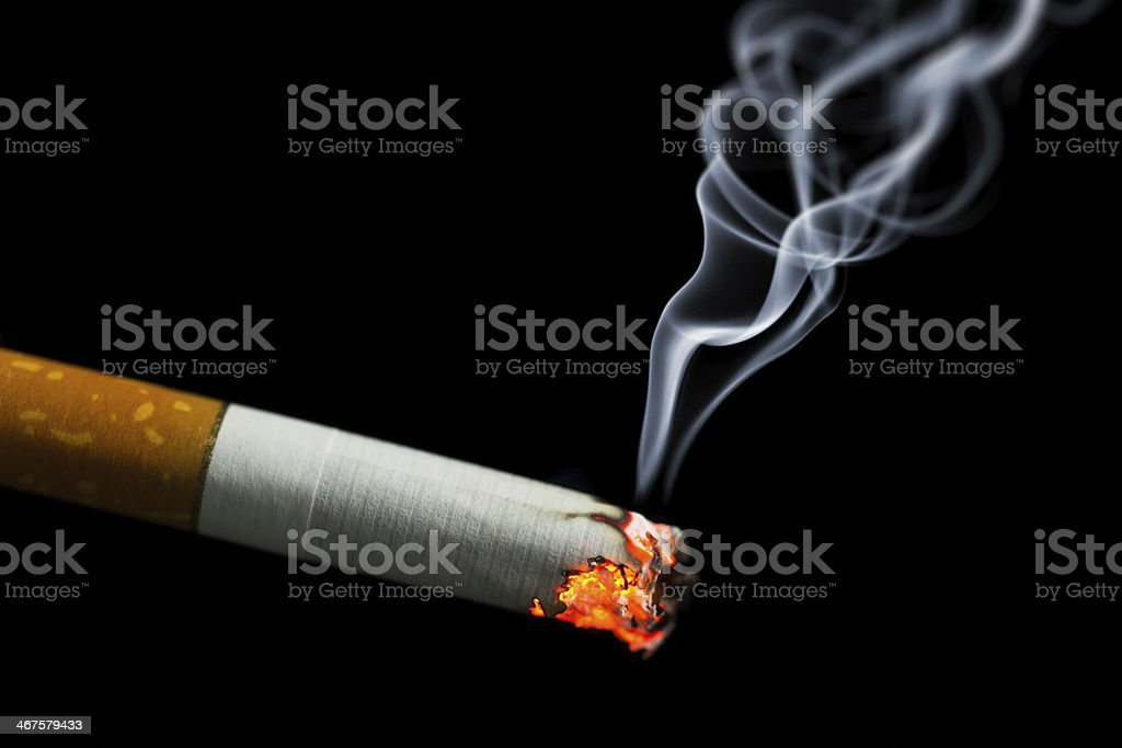 burning cigarette with smoke stock photo