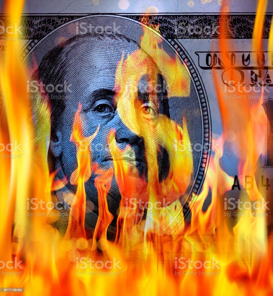 burning dollar bil concept stock photo