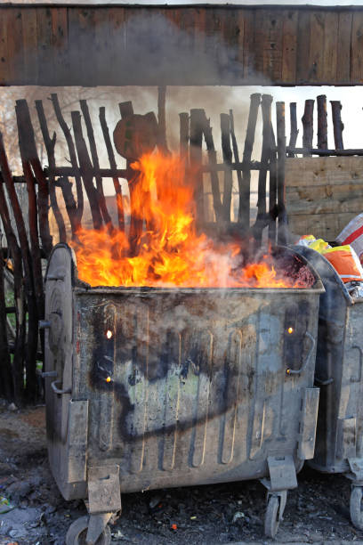 Burning Dumpster Dumpster Fire With Hot Flames From Garbage dumpster fire stock pictures, royalty-free photos & images