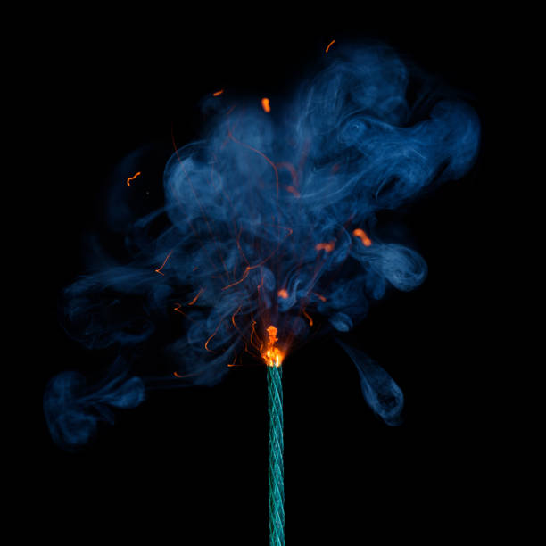 Burning dynamite fuse with sparks and smoke isolated Burning dynamite fuse with sparks and smoke isolated on black background. pyrotechnic effects stock pictures, royalty-free photos & images