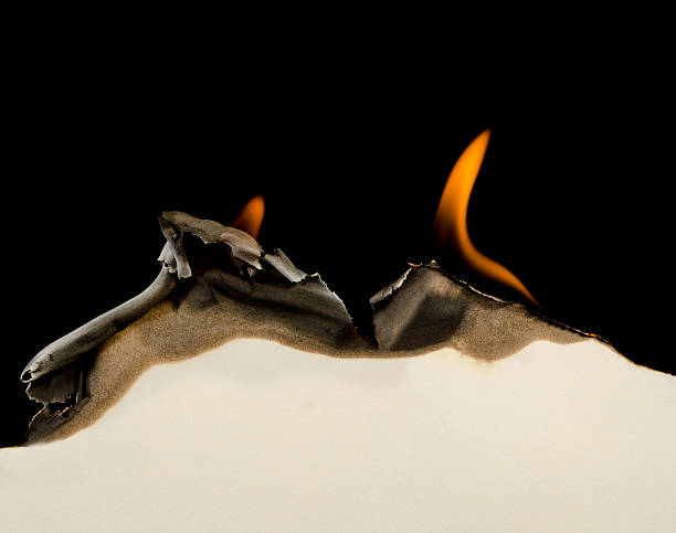 burning edge of paper - burning stock pictures, royalty-free photos & images