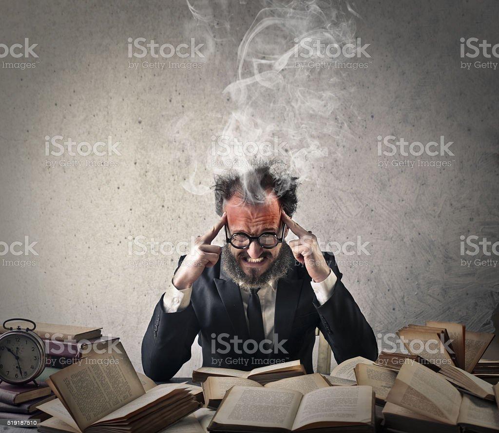 Man focusing hard on his work