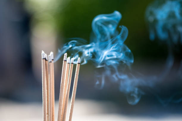 burning Embossed  sticks and smoke from incense burning and smoke burning Embossed  sticks and smoke from incense burning and smoke incense stock pictures, royalty-free photos & images