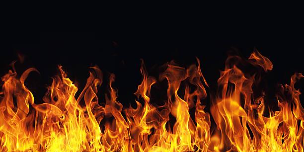 burning fire flame on black background burning fire flame on black background flame stock pictures, royalty-free photos & images