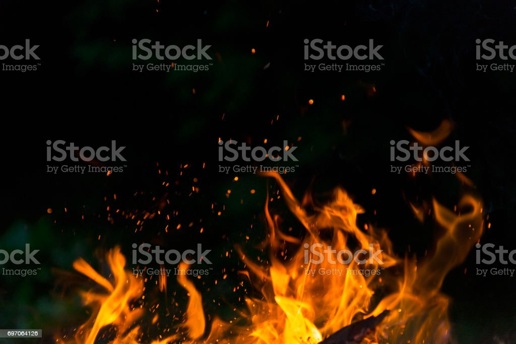 Burning fire flame on black background stock photo