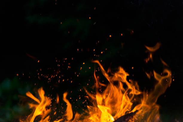 Burning fire flame on black background stock photo