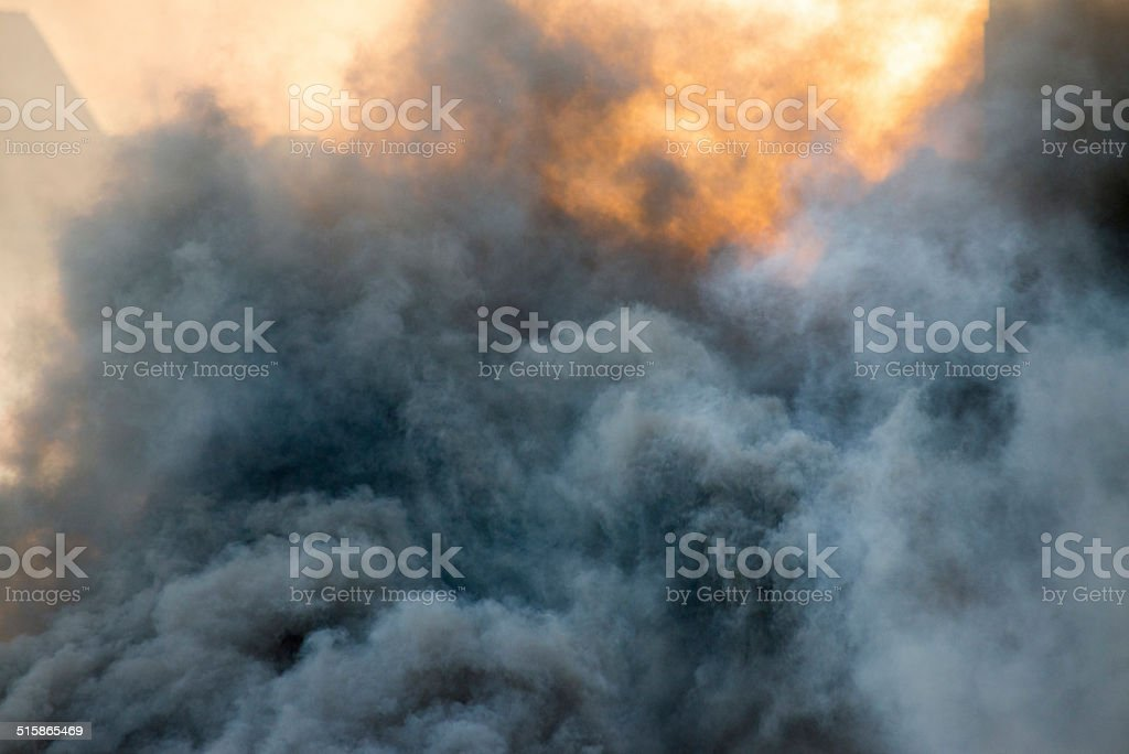 burning fire flame on wooden house stock photo