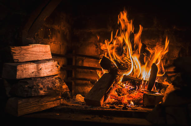 Burning fire in open fireplace with wooden fuel (firewood) Fireplace, Fire - Natural Phenomenon, Winter, Flame, Brick log fire stock pictures, royalty-free photos & images