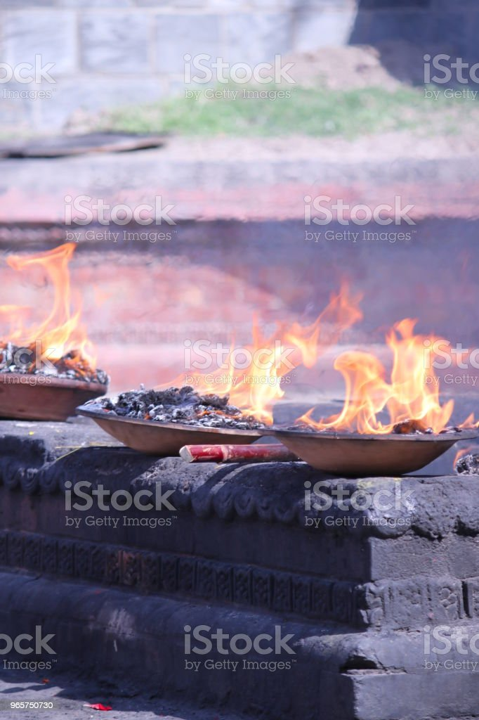 Burning fire in the altars. Pashupatinath Temple - Royalty-free Bagmati Stock Photo