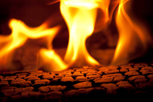 Burning Fire Hot coals and flames emitting from a hot burning fire. log fire stock pictures, royalty-free photos & images