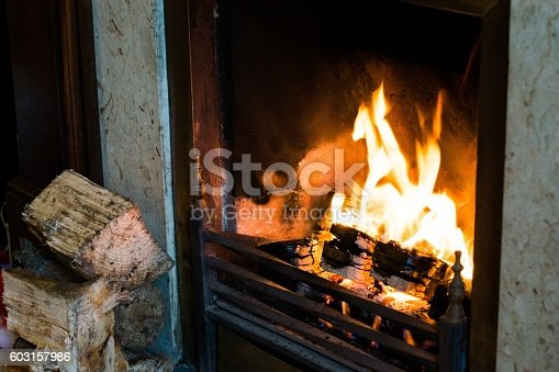 Traditional fireplace with cement setting.