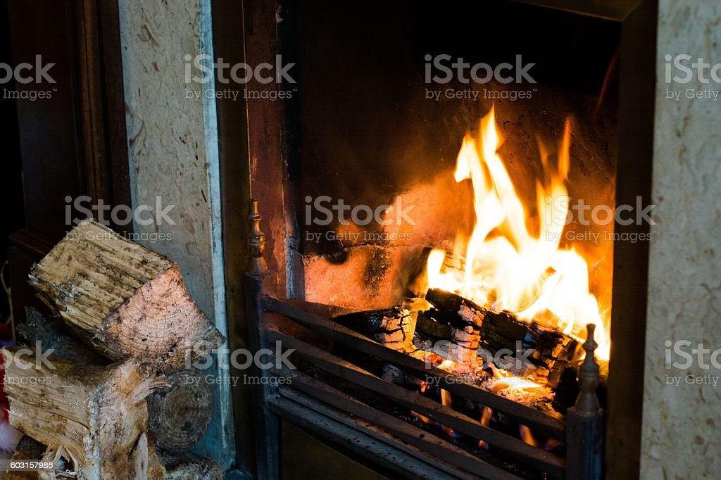 Burning fire place with wood stock photo