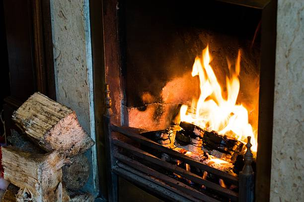 Burning fire place with wood Traditional fireplace with cement setting. log fire stock pictures, royalty-free photos & images