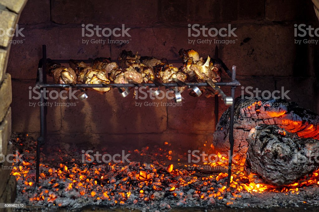 Burning fireplace and barbecue pork stock photo