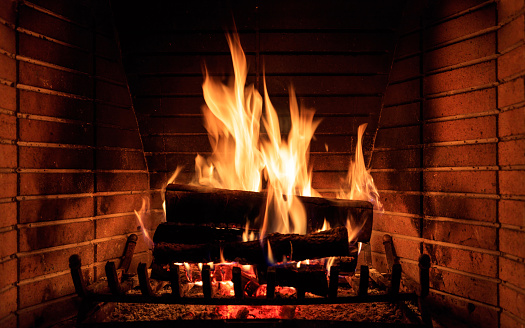 Burning fireplace at home