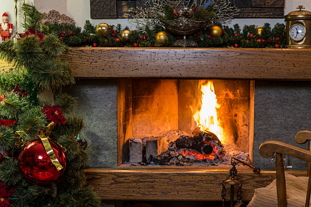 Burning fireplace with christmas decorations stock photo