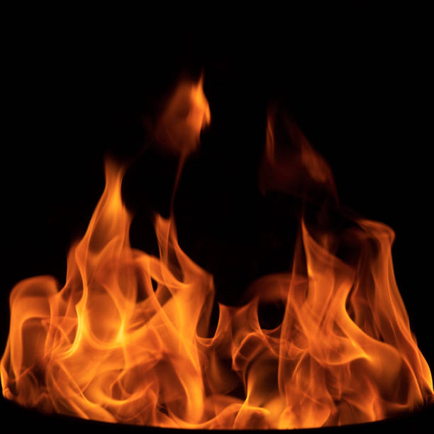 burning flame isolated on black - flame stock pictures, royalty-free photos & images