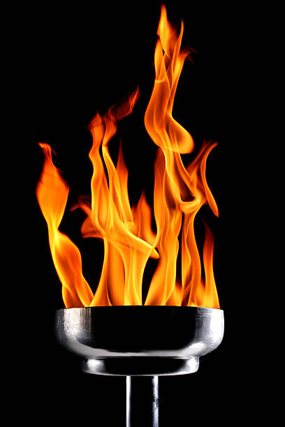 burning flaming torch burning flaming torch over black background. flaming torch stock pictures, royalty-free photos & images