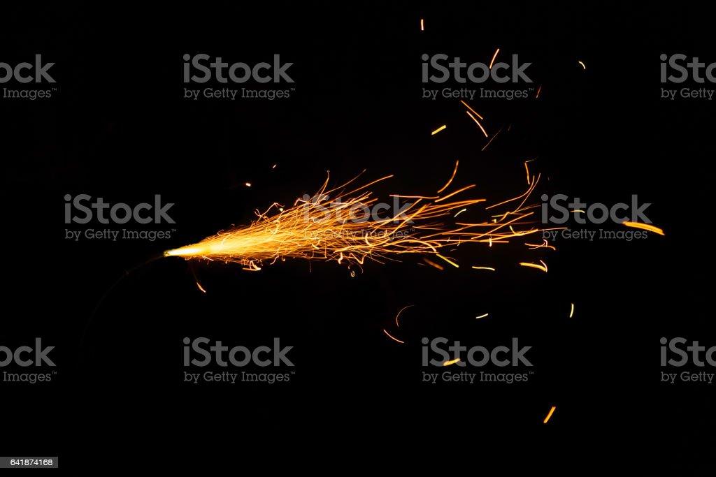 Burning fuse on black background stock photo