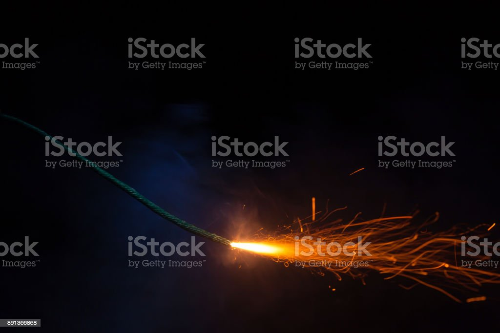 Burning fuse with sparks on black background royalty-free stock photo